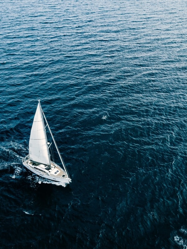 Aerial View Of Sailing Ship Yachts With White Sails In Windy Con
